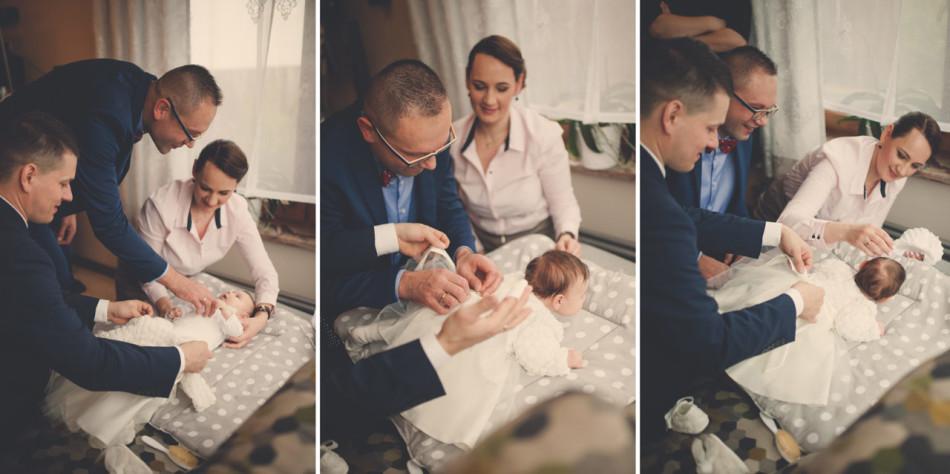 Zdjęcia z chrztu bueranie dziecka podczas przygotowań do ceremonii