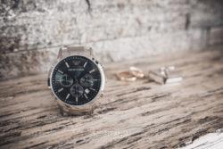 Detale ślubne zegarek, spinki i obrączki